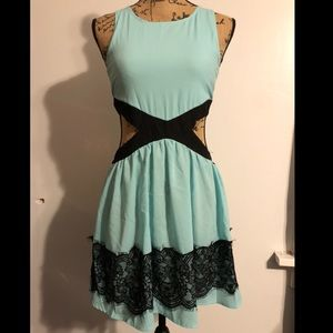 Teal and black cut out dress.